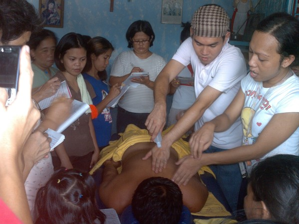 Apu Adman demonstrating Hilot Masahe during community outreach training